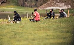 THEMENBILD - arabische Touristen sitzen auf einer Wiese in der Nähe eines Bergsees, fotografieren mit ihren Handys und bereiten Tee zu. Der Hintersee ist ein kleiner Gebirgssee in 1313 m Höhe im Talschluss des Felbertals in Mittersill. Der Bergsee ist ein Naturdenkmal und wurde unter Schutz gestellt. Der Hintersee gilt als Geheimtipp, Erholungsgebiet und ein Platz, den man gesehen haben muss, aufgenommen am 23. Juni 2019, am Hintersee in Mittersill, Österreich // Arab tourists sit on a meadow near a mountain lake, photograph with their mobile phones and prepare tea. Hintersee is a small mountain lake 1313 m above sea level at the end of the Felbertal valley in Mittersill. The mountain lake is a natural monument and was placed under protection. The Hintersee is an insider tip, a place you must have seen and a recreation area on 2019/06/23, Hintersee in Mittersill, Austria. EXPA Pictures © 2019, PhotoCredit: EXPA/ Stefanie Oberhauser