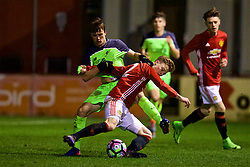 ALTRINGHAM, ENGLAND - Friday, March 10, 2017: Liverpool's Liam Miller in action against Manchester United's George Tanner during an Under-18 FA Premier League Merit Group A match at Moss Lane. (Pic by David Rawcliffe/Propaganda)