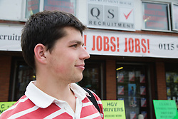 Young Czech man outside recruitment agency,