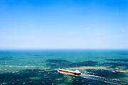 Nederland, Zuid-Holland, Rotterdam, 10-06-2015;  scheepvaartverkeer in de Maasgeul en Maasmond. Ingang van de Rotterdamse haven, gezien naar de Noordzee met rechts de Noorderdam.<br /> Entrance to the Port of Rotterdam w. shipping traffic.<br /> luchtfoto (toeslag op standard tarieven);<br /> aerial photo (additional fee required);<br /> copyright foto/photo Siebe Swart