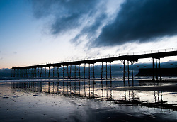 © Licensed to London News Pictures. 10/03/2014<br /> <br /> Saltburn, Cleveland, United Kingdom<br /> <br /> The Victorian Pier is reflected in wet sand at first light in Saltburn by the Sea in Cleveland<br /> <br /> Photo credit : Ian Forsyth/LNP
