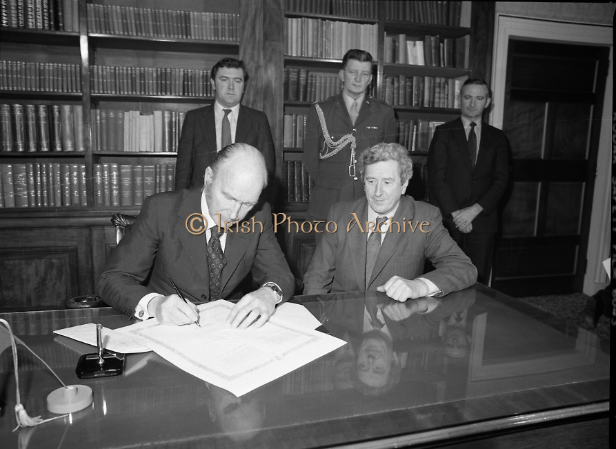 Dissolution of 22nd   Dáil Éireann 1982. .27/01/1982.01/27/82.27th January 1982.Image of the President, Patrick Hillary, singing warrant of dissolution of the Dáil. The signing was carried out at  Áras an Uachtaráin.