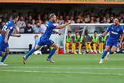 AFC Wimbledon midfielder Scott Wagstaff (7) celebrating after scoring goal to make it 1-0 during the EFL Cup match between AFC Wimbledon and Milton Keynes Dons at the Cherry Red Records Stadium, Kingston, England on 13 August 2019.