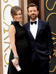 Olivia Wilde with Jason Sudeikis arriving to the 2014 Oscars at the Hollywood and Highland Center in Hollywood, California, USA,  Sunday, 2nd March 2014. Picture by Hollywood Bubbles / i-Images<br /> UK ONLY