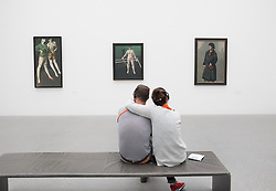 Couple looking at paintings at Pinakothek Museum in Munich Germany
