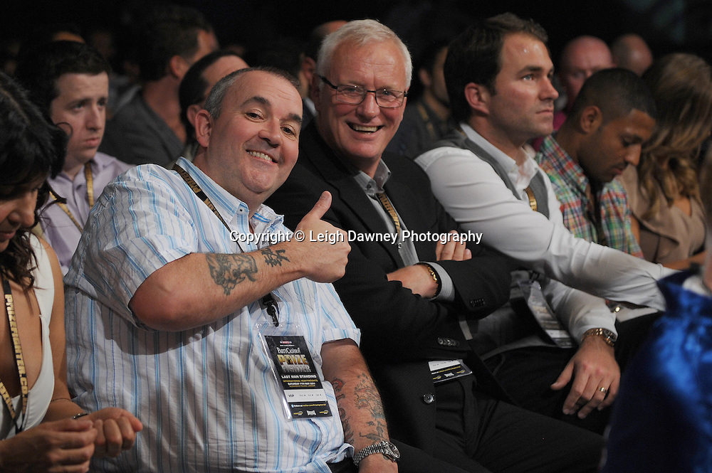 (left to right) World Darts Champion Phil Taylor, Promoters Barry & Eddie Hearn ringside at Prizefighter International on Saturday 7th May 2011. Prizefighter / Matchroom. Photo credit © Leigh Dawney. Alexandra Palace, London.