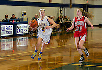 Gilford's Brooke Beaudet charges the ball down court ahead of Moultonboro's Kaleigh MacDonald during first round game action at the 42 annual Holiday Basketball Tournament Monday evening at Gilford High School. (Karen Bobotas/for the Laconia Daily Sun)