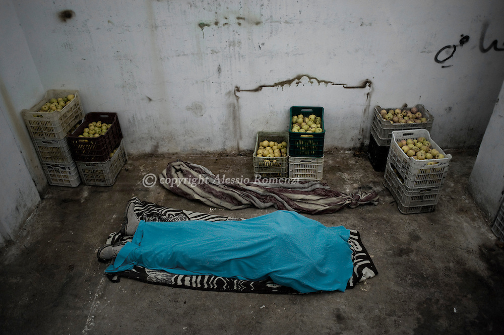 SYRIA - Al Qsair. The body of a killed member of  the Free Syrian Army, Mohammed Al Deiri, lies in an apple's storage refrigerator in Al Qsair, on February 9, 2012. ALESSIO ROMENZI