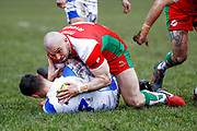 Keighley Cougars centre Adam Ryder (4) in the tackle  during the Betfred League 1 match between Keighley Cougars and Workington Town at Cougar Park, Keighley, United Kingdom on 18 February 2018. Picture by Simon Davies.