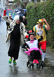 © Licensed to London News Pictures.01/01/2018<br /> SUTTON VALENCE, UK.<br /> MICKEY MOUSE TEAM  (4TH)<br /> The traditional New Years day Sutton Valence Pram Race in Kent continued this year. In its 38th year the Race was struck by tragedy last year when competitor Francis 'Titch' O' Sullivan tipped over in his spitfire pram and hit his head on the curb, he passed away a day later. A coroners court reported he was not wearing a helmet.<br />  All babies in the pram's have to wear a helmet and the pushers must have contact with the pram and the ground at all times.<br />  <br /> Photo credit: Grant Falvey/LNP