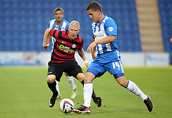 Peterborough United's Craig Alcock in action with Colchester United's Andy Bond  - Photo mandatory by-line: Joe Dent/JMP - Tel: Mobile: 07966 386802 06/08/2013 - SPORT - FOOTBALL - Weston Homes Community Stadium - Colchester -  Colchester United V Peterborough United - Capital One Cup - First Round