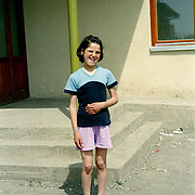 Girl outside a school in Pristina, Kosovo.  Schooling is provided with the aid of ngo aid.