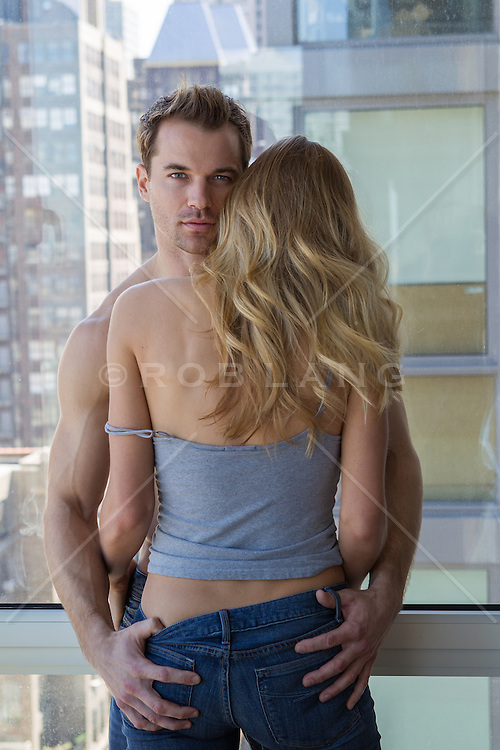 man holding a hot girls ass in an apartment in New York City