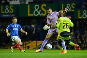 A mix up between Ali Al-Habsi and Michael Hector leads to Conor Chaplin scoring for Portsmouth during the Capital One Cup match between Portsmouth and Reading at Fratton Park, Portsmouth, England on 25 August 2015. Photo by Adam Rivers.