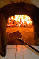 Wood-fired pizza oven at Lotus Cottages in Candidasa, Bali, Indonesia