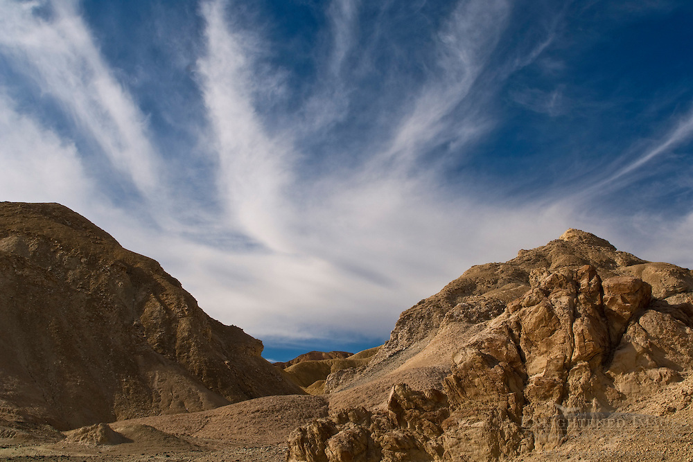 Cloud & Eroded hillside, Twenty Mule Team Canyon, Death Valley National Park, California