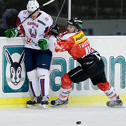 Morris Trachsler of Switzerland vs Damjan Dervaric of Slovenia during friendly ice-hockey match between Slovenia and Switzerland, on December 14, 2011 at Hala Tivoli, Ljubljana, Slovenia. (Photo By Matic Klansek Velej / Sportida)