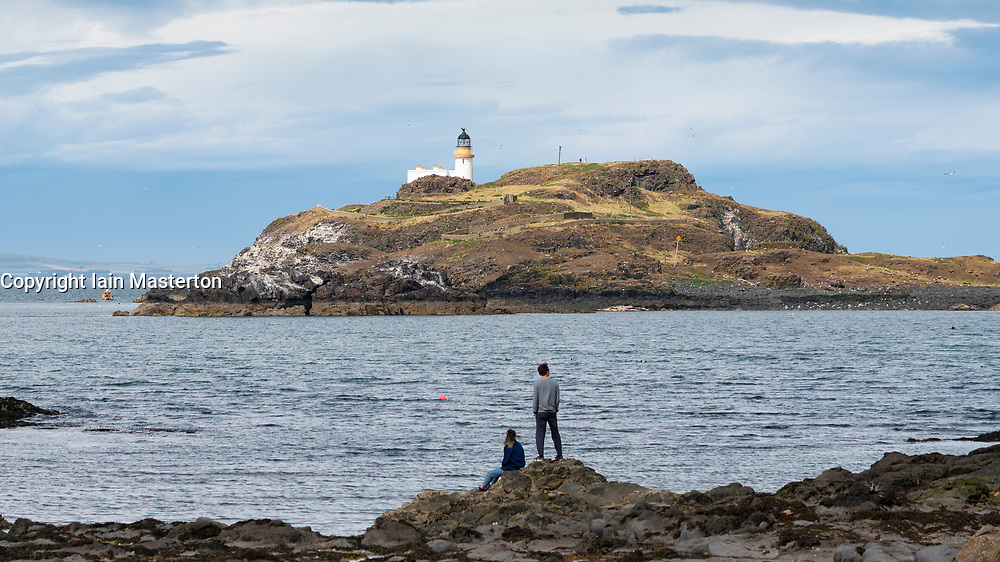 View of Fidra Island and lighthouse from Yellowcraig on Firth of Forth in  East Lothian, Scotland, UK