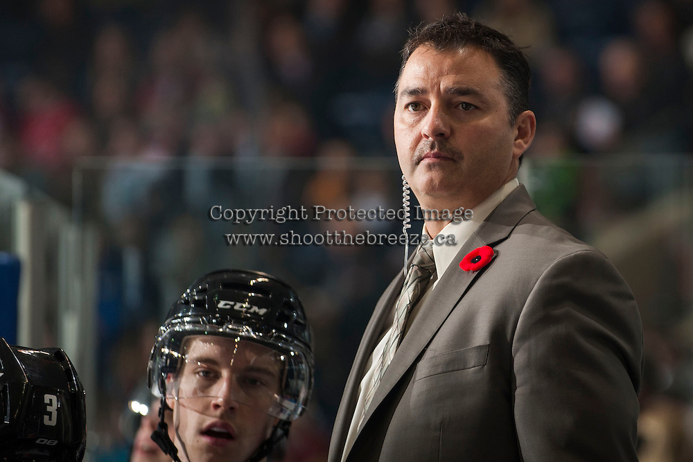 KELOWNA, CANADA - NOVEMBER 9:  Dan Lambert, coach of the Kelowna Rockets stands on the bench opposite the Red Deer Rebels at the Kelowna Rockets on November 9, 2012 at Prospera Place in Kelowna, British Columbia, Canada (Photo by Marissa Baecker/Shoot the Breeze) *** Local Caption ***