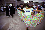 MEXICO, FESTIVALS, DAYS OF THE DEAD Masked figures doing a 'Danza de Muerto' or dance of death in Mitla near Oaxaca at dusk on November 3rd.