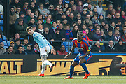 Manchester City defender John Stones (5) and Crystal Palace forward Christian Benteke (17) during the Premier League match between Crystal Palace and Manchester City at Selhurst Park, London, England on 14 April 2019.