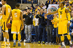 Feb 6, 2016; Morgantown, WV, USA; West Virginia Mountaineers fans cheer after a foul was called during the first half against the Baylor Bears at the WVU Coliseum. Mandatory Credit: Ben Queen-USA TODAY Sports