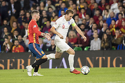 October 15, 2018 - Seville, Spain - HARRY KANE of England (R) vies for the ball with SERGIO RAMOS of Spain(L) during the UEFA Nations League Group A4 soccer match between Spain and England at the Benito Villamarin Stadium (Credit Image: © Daniel Gonzalez Acuna/ZUMA Wire)