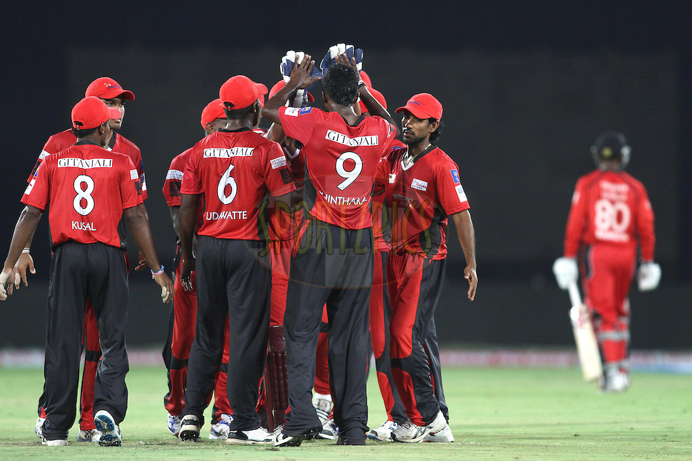 Ruhunu Eleven celebrate Denesh Ramdin of Trinidad and Tobago wicket during the Q1 match between Trinidad & Tobago and Ruhunu Eleven held at the Rajiv Gandhi International Stadium, Hyderabad on the 19th September 2011..Photo by Shaun Roy/BCCI/SPORTZPICS