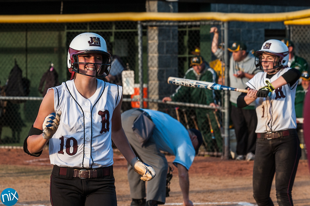 Jay M. Robinson's Tori Zavodny smiles after hitting a home run against Central Cabarrus Friday night at Central Cabarrus High School. Robinson won the game 9-5.