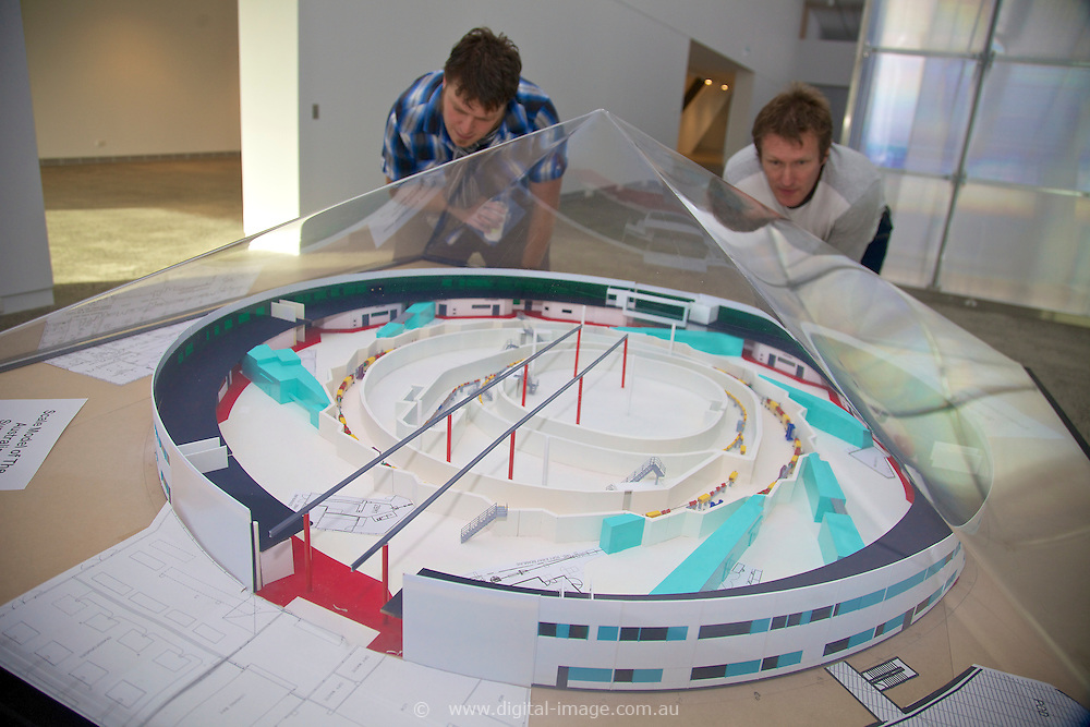 Architectural model of the main building at the Australian Synchrtron  person looking at the model