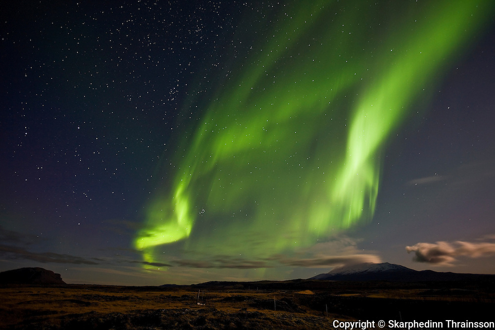 Aurora Borealis along with the volcano Hekla and mountain Búrfell, south Iceland