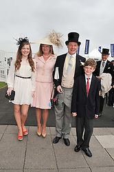 The HON.PETER & MRS STANLEY with their children ISABEL & ARGIE at the 2012 Investec sponsored Derby at Epsom Racecourse, Epsom, Surrey on 2nd June 2012.