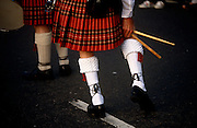 A drummer with the Argyll and Sutherland Highlanders a regiment of the British Army, bends down to adjust a sock during inspection. The Argyll and Sutherland Highlanders (Princess Louise's) was an infantry regiment of the British Army until amalgamation into The Royal Regiment of Scotland in 2006. The regiment was created in 1881 as an amalgamation of the 91st and 93rd Regiments of Foot going on to serve in the First and Second World Wars, Korea, Aden. It was announced in 2004 as part of the restructuring of the infantry that the Highlanders would be amalgamated with the other Scottish infantry regiments into a single seven battalion strong Royal Regiment of Scotland...