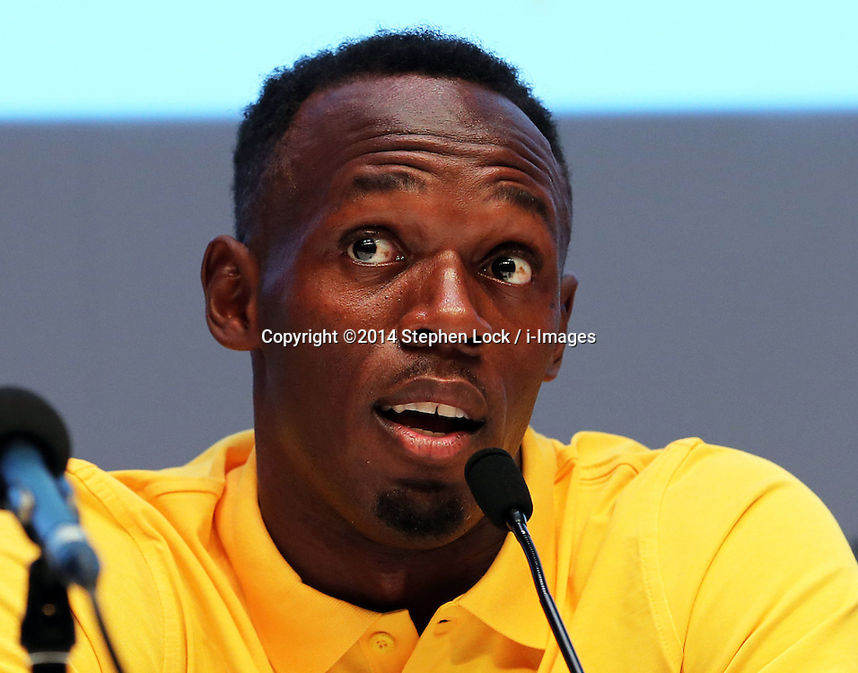 Image licensed to i-Images Picture Agency. 26/07/2014. Glasgow, United Kingdom. Usain Bolt speaking at  a press conference on day three of the Commonwealth Games in Glasgow where he confirmed his attendance in the Relay event at the Games.  Picture by Stephen Lock / i-Images