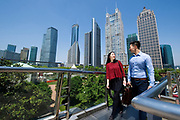 SHANGHAI, CHINA - MAY 12: Jason Zhai and Snowy Jiang walk on a pedestrian bridge on their way to work in the morning in Luziajui Pudong business district, on May 12, 2015, in Shanghai, China. (Photo by Lucas Schifres/Pictobank)