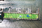 City golfers at the Chelsea Piers drive balls out onto the caged pier on the Hudson River.  Once a docking point for luxury ship liners in the early 20th century, the piers have been revitalized as a center for leisure with spas, sports facilities, and maritime centers.
