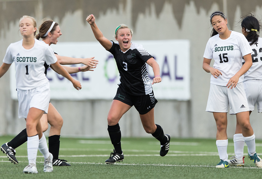 Omaha Skutt's Jess Schlautman, No. 3, celebrates after scoring the SkyHawks second goal of the game. Omaha Skutt played Columbus Scotus in the Class B girls Nebraska state soccer championship at Morrison Stadium on Wednesday, May 17, 2017, in Omaha.<br /> <br /> MATT DIXON/THE WORLD-HERALD