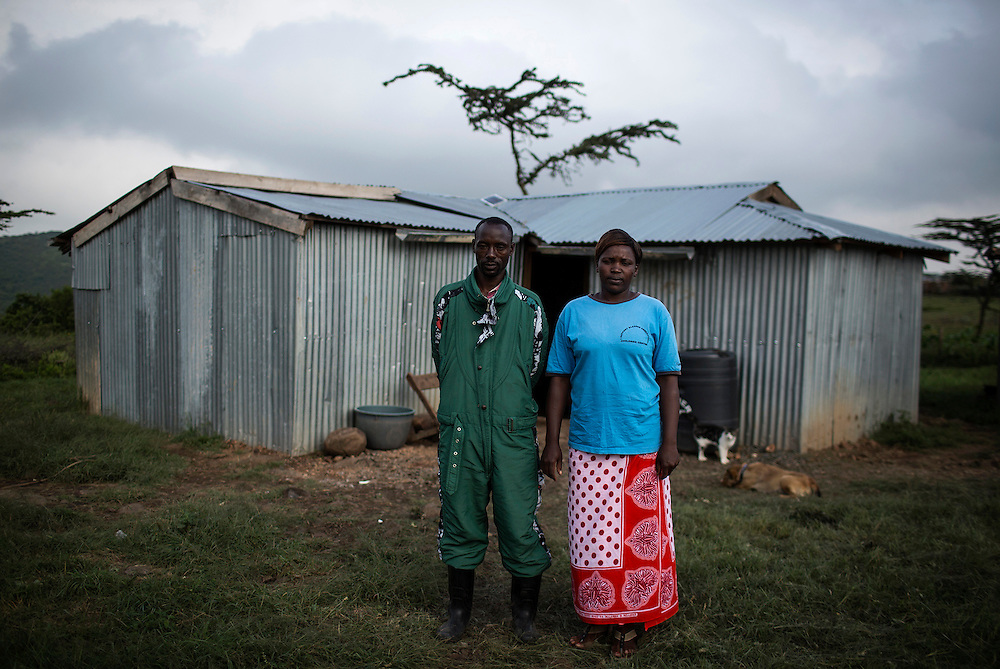 Nicholas and Faith Papei Saltaban in front of their hut near the Rift Valley, some two hours by car from Nairobi. This Maasai family are customers of M-KOPA Solar.