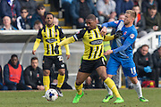 Hartlepool United midfielder Nicky Featherstone and Andre Boucaud (Midfielder) Dagenham & Redbridge compete for the ball during the Sky Bet League 2 match between Hartlepool United and Dagenham and Redbridge at Victoria Park, Hartlepool, England on 12 March 2016. Photo by George Ledger.