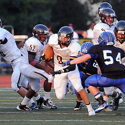 Photos by Tom Kelly IV<br /> Avon Grove's Stephen McDannald (8) runs the ball during the Avon Grove at Kennett, Friday night football game under the lights, August 30, 2013.