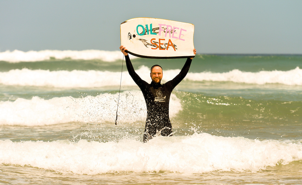 Oil Free Seas boogie board protester at Baylys Beach,  taking part in the West Coast Banner Day,  Dargaville, New Zealand, Saturday,November 23, 2013. Credit:SNPA / Malcolm Pullman