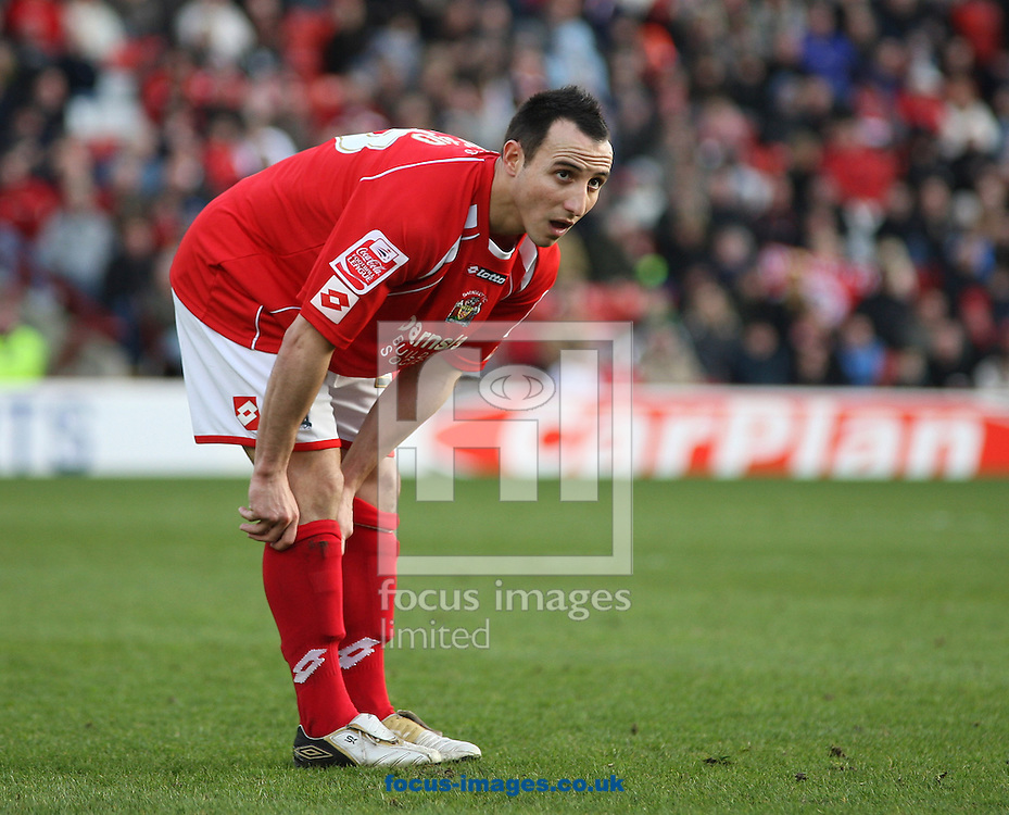 Barnsley - Saturday 21st February 2009 : Michael Mifsud of Barnsley pulls up his socks during the Coca Cola Championship match at Oakwell, Barnsley. (Pic by Steven Price/Focus Images)