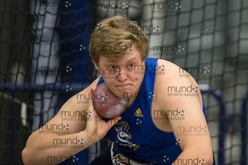 Windsor, Ontario ---2015-03-14--- Peter Millman of Lethbridge competes in the shot put at the 2015 CIS Track and Field Championships in Windsor, Ontario, March 14, 2015.<br /> GEOFF ROBINS/ Mundo Sport Images