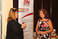 Tammy Oliver of Benefits Network Insurance Agency (left) and Pam Strickler of Congressman Steve Austria's office during the Dayton Area Chamber of Commerce Breakfast Briefing at the Dayton Racquet Club in downtown Dayton, Friday, July 13, 2012.
