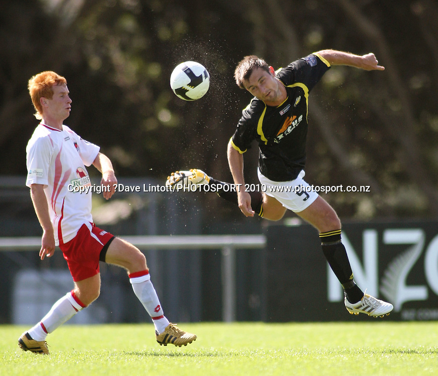 Wellington's Michael Winsauer heads the ball under pressure from Aaron Clapham.<br /> NZFC soccer  - Team Wellington v Canterbury United at Porirua Park, Wellington. Sunday, 14 March 2010. Photo: Dave Lintott/PHOTOSPORT