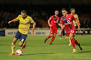 Oxford United midfielder Liam Sercombe  and York City forward, on loan from Oldham Athletic, Rhys Turner during the Sky Bet League 2 match between York City and Oxford United at Bootham Crescent, York, England on 29 September 2015. Photo by Simon Davies.