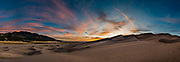 Sunset. Dunes rise up to 750 feet tall in Great Sand Dunes National Park and Preserve, on the eastern edge of San Luis Valley, Sangre de Cristo Range, south-central Colorado, USA. This image was stitched from multiple overlapping photos.