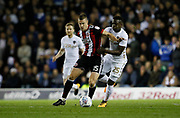 Sheffield United's Paul Coutts goes past Ronaldo Vieira of Leeds United  during the EFL Sky Bet Championship match between Leeds United and Sheffield Utd at Elland Road, Leeds, England on 27 October 2017. Photo by Paul Thompson.