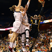 Odyssey Sims, (right), Tulsa Shock, is rejected and fouled while driving to the basket by Katie Douglas, Connecticut Sun, assisted by team mate Kelsey Griffin, (left), during the Connecticut Sun Vs Tulsa Shock WNBA regular season game at Mohegan Sun Arena, Uncasville, Connecticut, USA. 3rd July 2014. Photo Tim Clayton