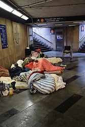 Homeless people sleeping in Metro, Budapest, Hungary, February 2017